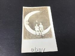 2 Young Boys On Paper Moon, One Holding Balloon Rppc Real Photo Postcard